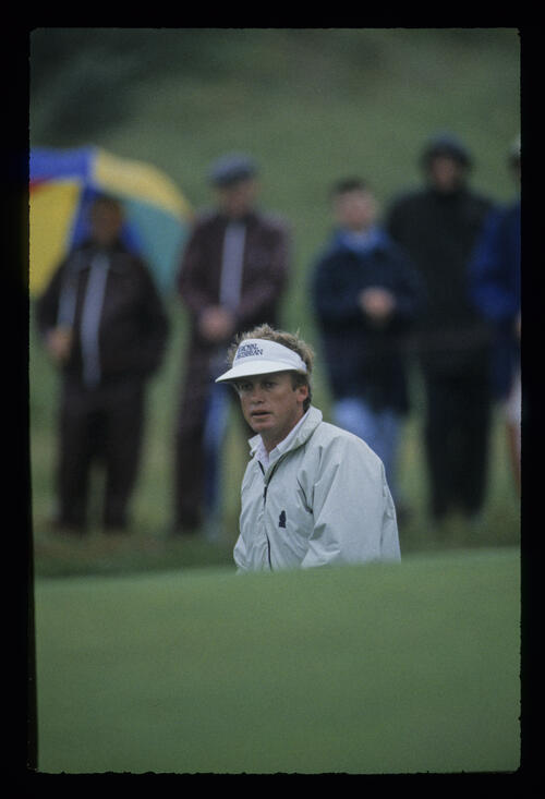 Wayne Grady deep in a bunker in the rain during the 1987 Open Championship