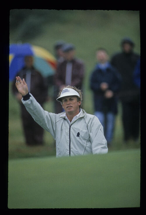 Wayne Grady raising his hand in a bunker during the 1987 Open Championship