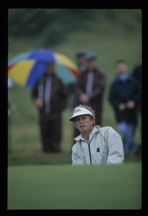Wayne Grady splashing from a bunker in the rain during the 1987 Open Championship