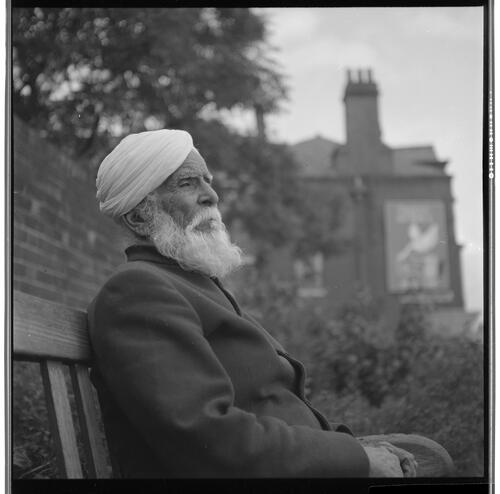 [An unidentified man with a white beard and a turban sitting on a bench, Rye Hill]