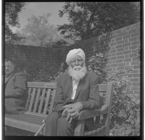 [An unidentified man with a white beard and a turban sitting on a bench with another man, Rye Hill]