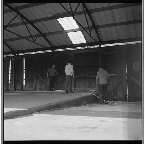 [Three unidentified men working in a building, at the docks, South Shields]
