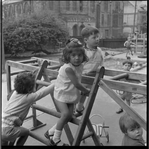[A group of unidentified small children playing in a playground, Rye Hill]