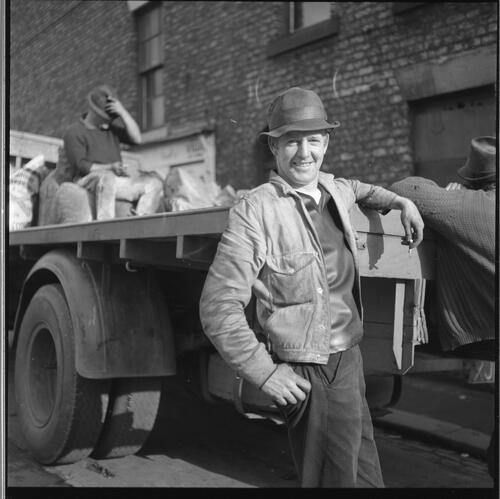 [Portrait of an unidentified man standing next to a lorry, Rye Hill]