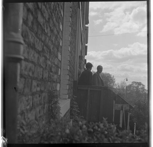 [Portrait of three unidentified men standing on steps in front of a building, Rye Hill]