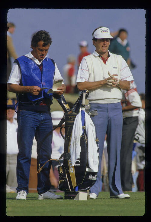 Jay Haas and his caddie considering their options on the tee during the 1987 Phoenix Open