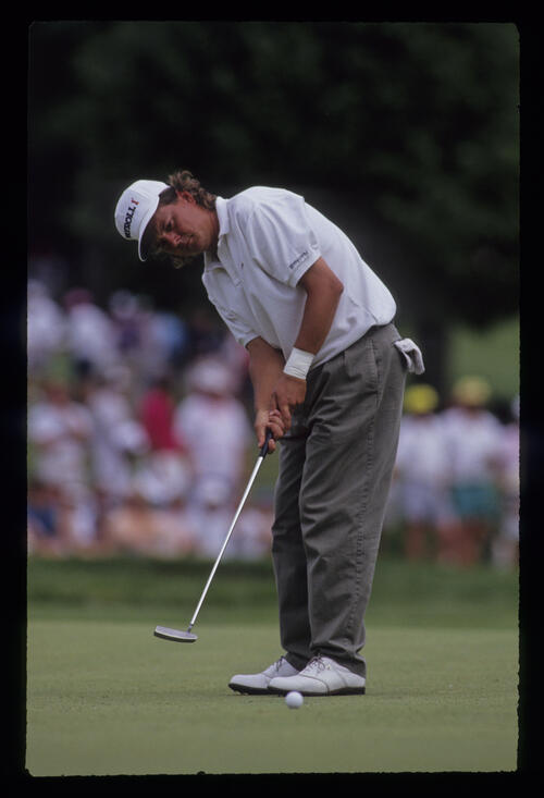 Nolan Henke putting during the 1991 US Open