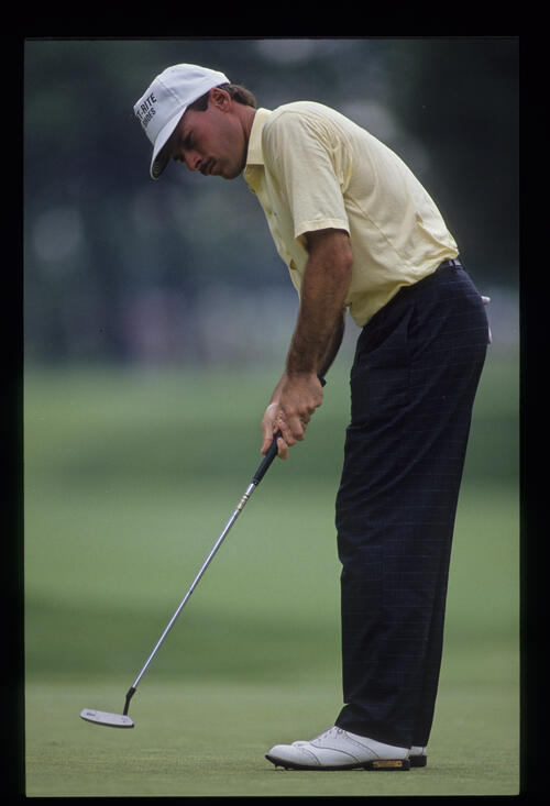 John Huston putting during the 1990 US Open