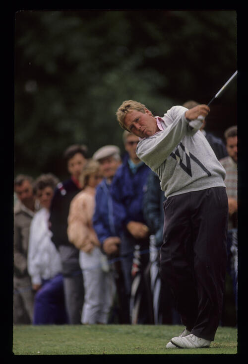 Richard Boxall extending through the ball during the 1990 NM English Open