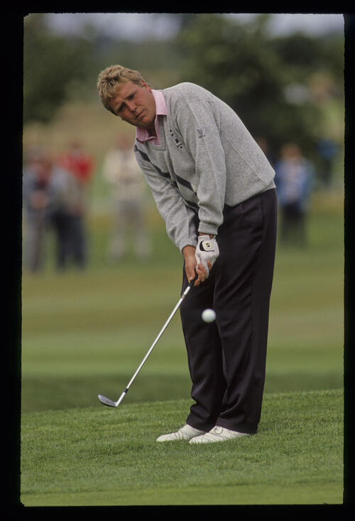 Richard Boxall chipping to the green during the 1990 NM English Open