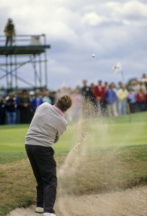 Richard Boxall splashing from a bunker during the 1990 NM English Open