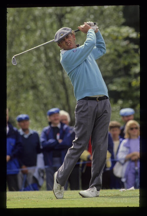 Carl Mason following through on the tee during the 1990 NM English Open