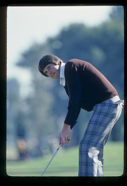Andy North crouching over a putt during the 1982 Phoenix Open