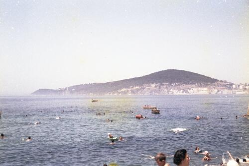 General view of people swimming along the coast of Turkey