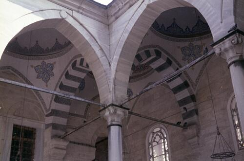 Unidentified Islamic courtyard with pointed arches and cupolas