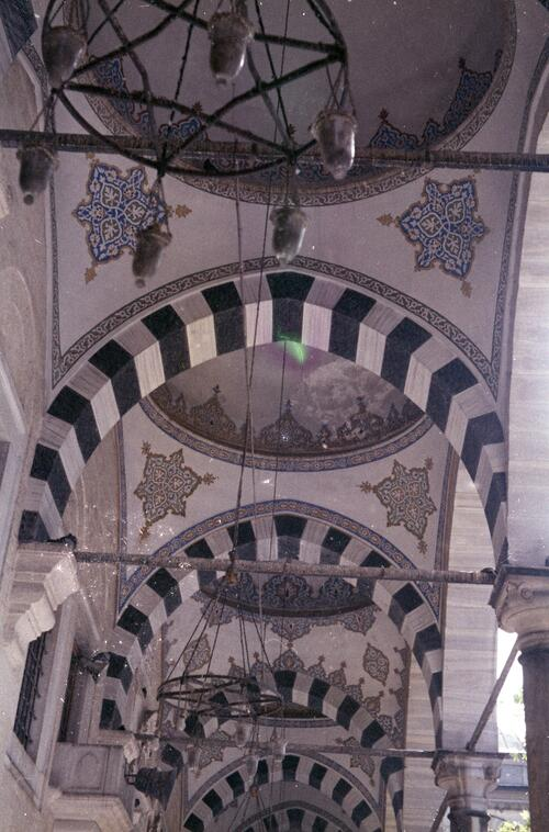 Detail from an unidentified Islamic courtyard with pointed arches and cupolas