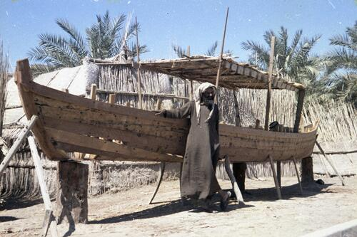 Unidentified Marsh Arab man building a boat