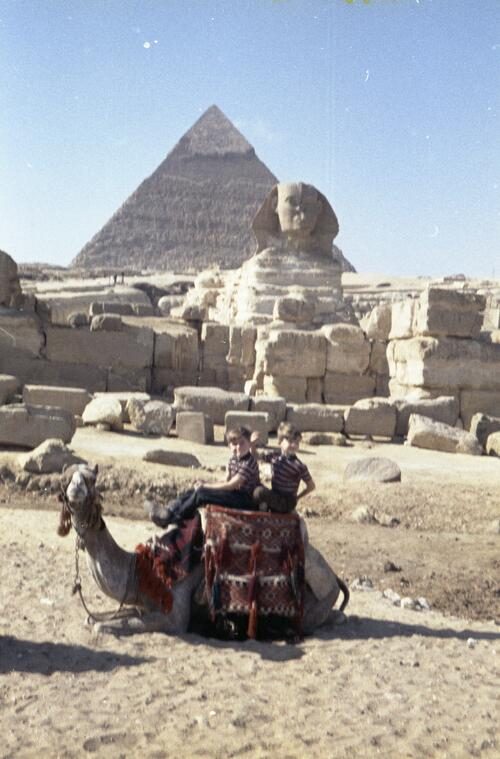 Two unidentified children in front of the Great Pyramid and Great Sphinx