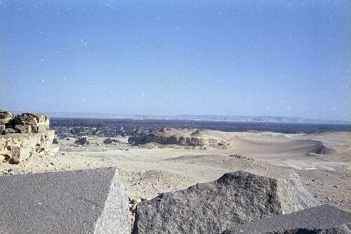 General view of the desert landscape and a city