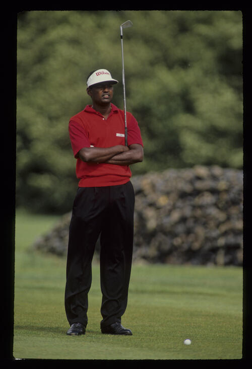 Vijay Singh waiting to hit with arms crossed during the 1990 NM English Open