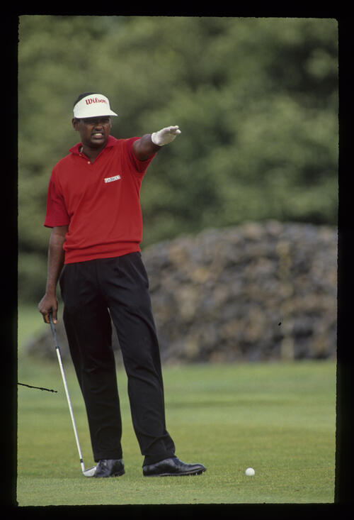 Vijay Singh pointing down the fairway during the 1990 NM English Open