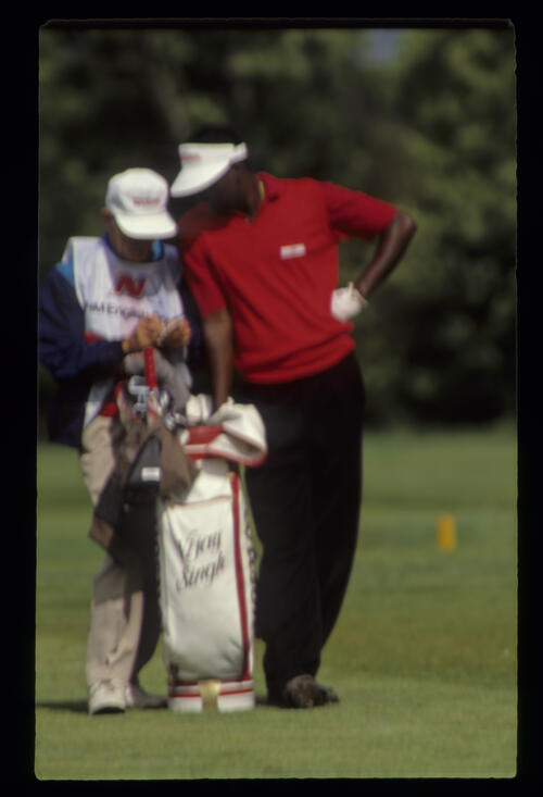 Vijay Singh and his caddie checking yardages during the 1990 NM English Open