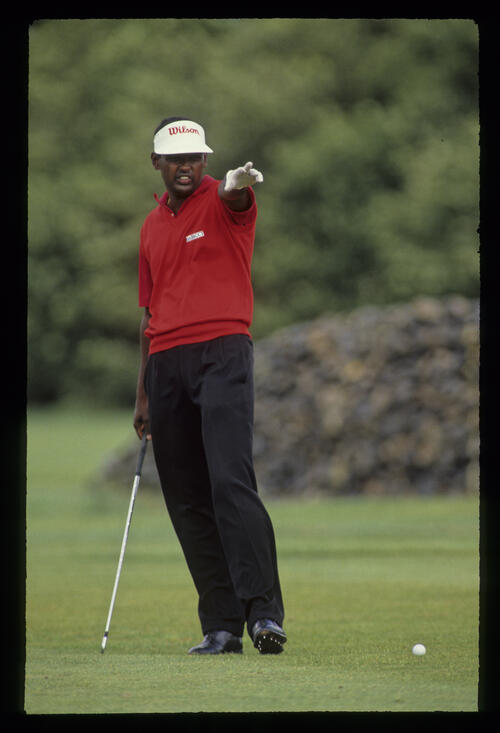 Vijay Singh pointing from the fairway during the 1990 NM English Open