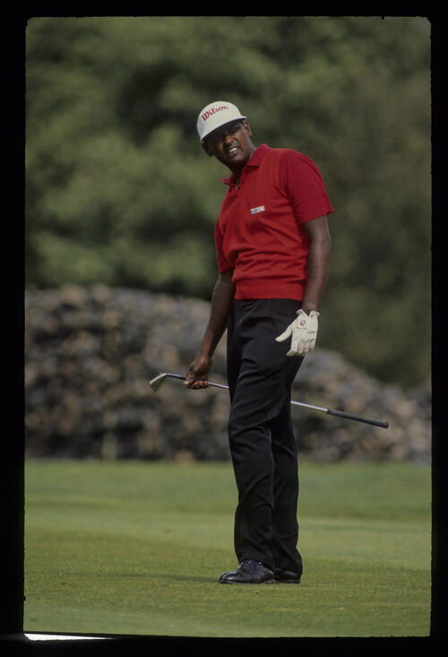 Vijay Singh watching closely from the fairway during the 1990 NM English Open