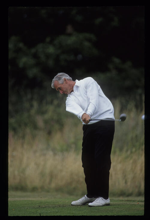 Brian Waites staying down through the ball on the tee during the 1992 British Seniors Open