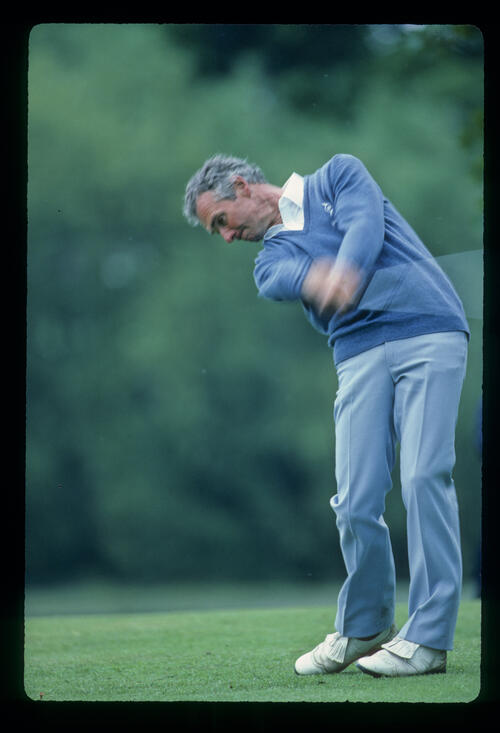 Brian Waites staying down through the ball on the fairway on his way to fifth place during the 1983 Silk Cut Masters