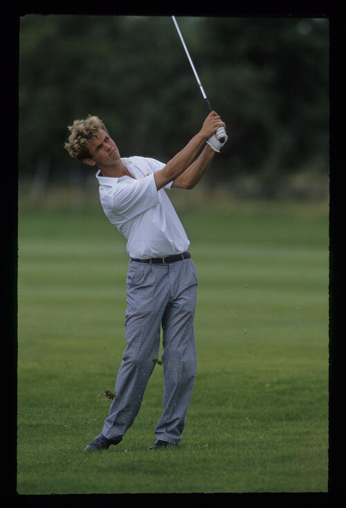 Andrew Coltart following through from the semi rough during the 1991 NM English Open