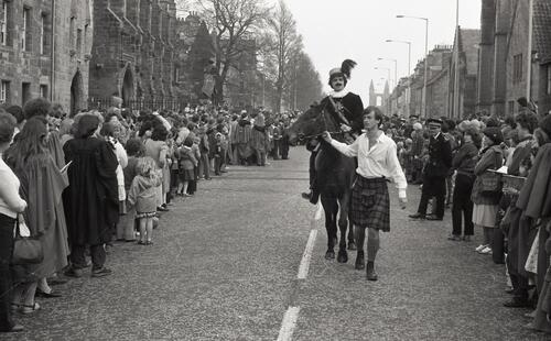 King James and page boy, the Kate Kennedy Procession, North Street, St Andrews.