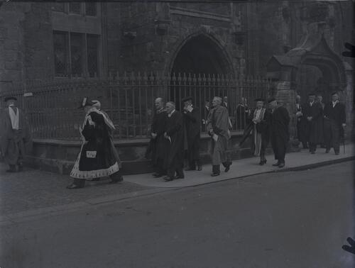 The Academic procession leaving University Chapel during the Earl of Crawford's installation, North Street, St Andrews.