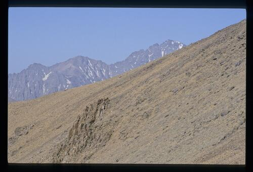From the Tizi Likemt, Thomson -correctly- suggested that this view was to the highest Atlas peak, now Jbel Toubhal.