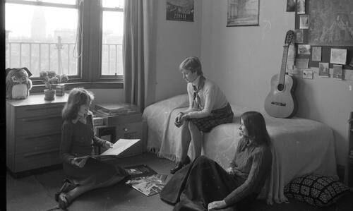 Students relaxing in a student's room, McIntosh Hall.