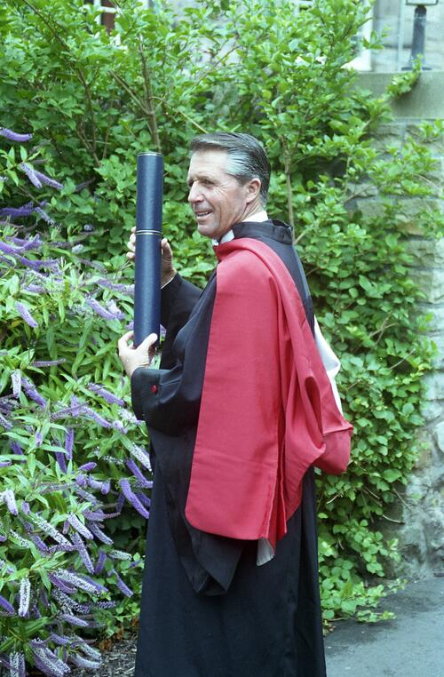 Honorary graduand, Gary Player, LL.D, with his degree roll after the graduation ceremony, University of St Andrews.