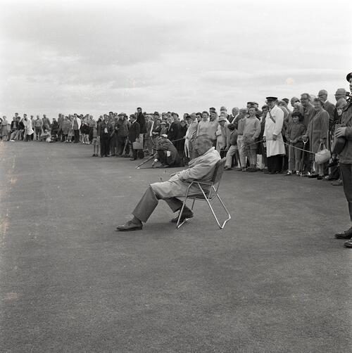 Henry Cotton waits to play during the Henry Cotton v Gene Sarazen golf match, filmed for TV [The Old Course, St Andrews].