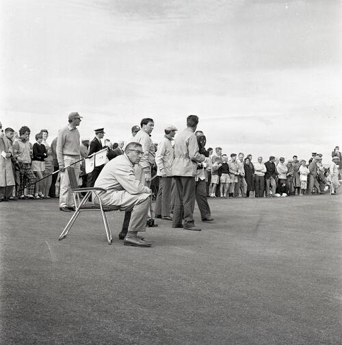 Henry Cotton watches Gene Sarazen's shot during the Henry Cotton v Gene Sarazen golf match, filmed for TV [The Old Course, St Andrews].