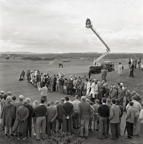 Henry Cotton tees off during the Henry Cotton v Gene Sarazen golf match, filmed for TV [The Old Course, St Andrews].