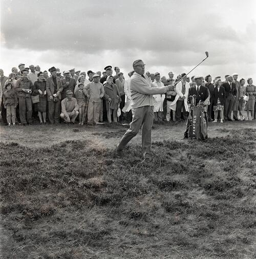 Henry Cotton plays out of the rough during the Henry Cotton v Gene Sarazen golf match, filmed for TV [The Old Course, St Andrews].