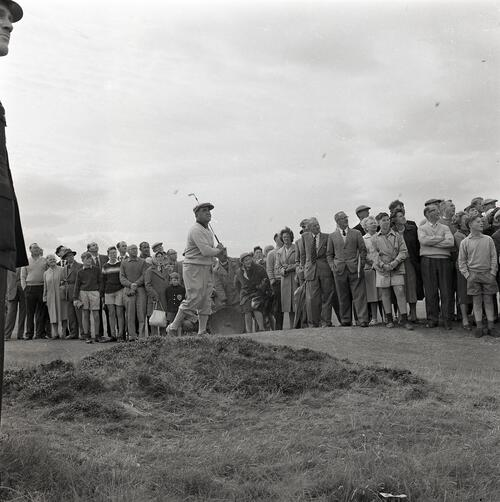 Gene Sarazen plays during the Henry Cotton v Gene Sarazen golf match, filmed for TV [The Old Course, St Andrews].