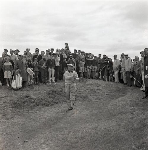 Gene Sarazen plays from the rough during the Henry Cotton v Gene Sarazen golf match, filmed for TV [The Old Course, St Andrews].