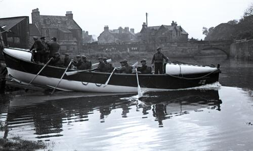 The crew in the lifeboat, the John and Sarah Hatfield as it is launched at St Andrews harbour.