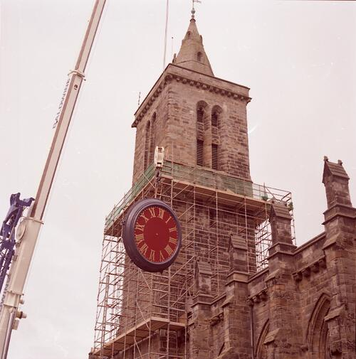 The Clock Dial being raised to St Salvator's College Tower, North Street, St Andrews.