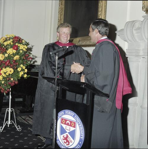Seve Ballesteros and Colin Montgomerie congratulate each other at the Golfers Graduation, University of St Andrews.