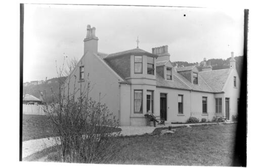W.G.M. outside Kames Cottage, Millport [Great Cumbrae].