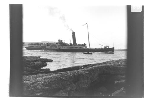 The Caledonia taking Millport Pier, from the Allans [Great Cumbrae].