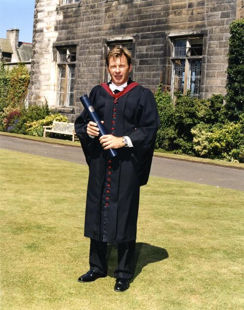 Nick Faldo on the lawn outside the Lower College Hall after graduation, University of St Andrews.