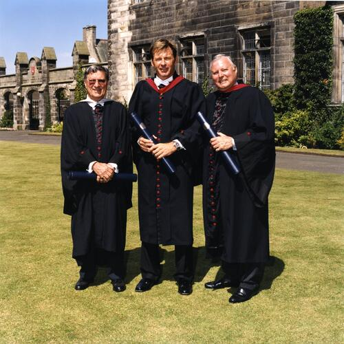 Peter Thomson, Nick Faldo and Peter Alliss on the lawn outside Lower College Hall after graduation, University of St Andrews.