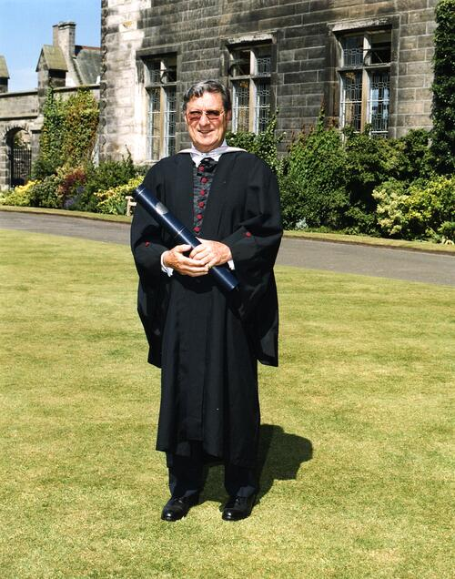 Peter Thomson on the lawn outside Lower College Hall after graduation, University of St Andrews.